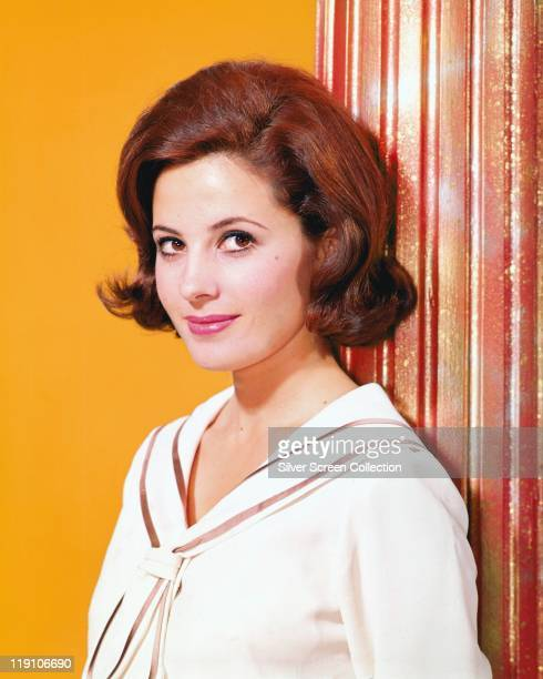 Barbara Parkins Canadian actress posing beside a curtain in a studio portrait against a yellow background circa 1965