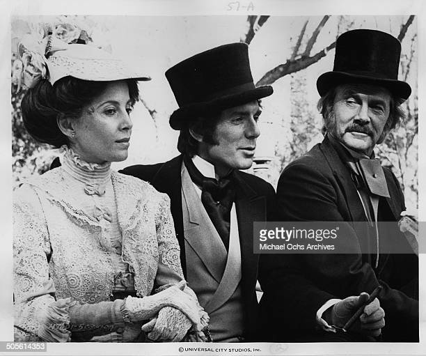 Barbara Parkins David Birney and Steve Forrest walk in a scene for the TVMini Series Testimony of Two Men circa 1977