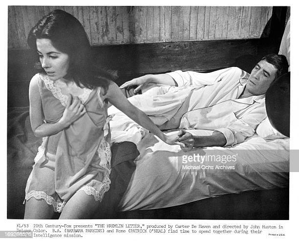 Barbara Parkins getting up from the bed with Patrick O'Neal in a scene from the film 'The Kremlin Letter' 1970