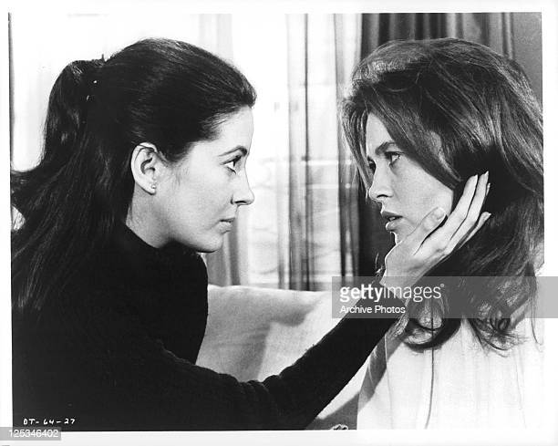 Barbara Parkins holds Faye Dunaway face in her hand in a scene from the film 'The Deadly Trap', 1971.