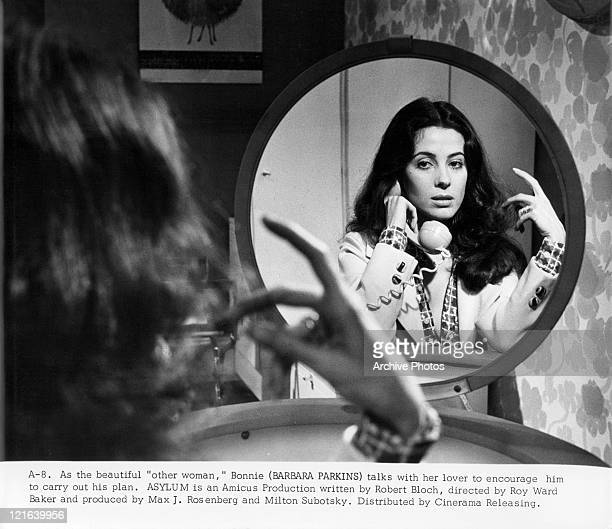 Barbara Parkins on the phone looking in the mirror in a scene from the film 'Asylum', 1972.