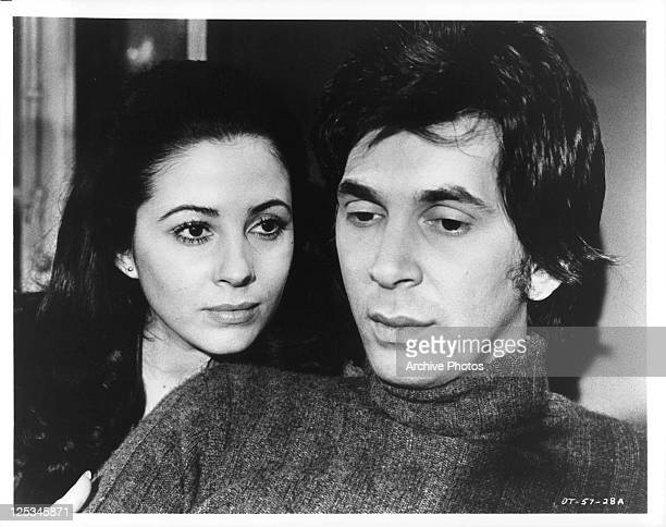 Barbara Parkins watches Frank Langella as they sit together in a scene from the film 'The Deadly Trap' 1971