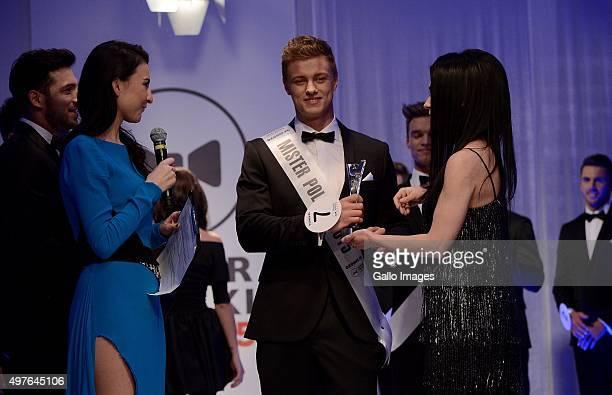 Barbara Pasek and Agnieszka Jastrzebska crown the winner, Rafal Jonkiszof, of the finale of the Mister Poland pageant on November 15, 2015 in Warsaw,...