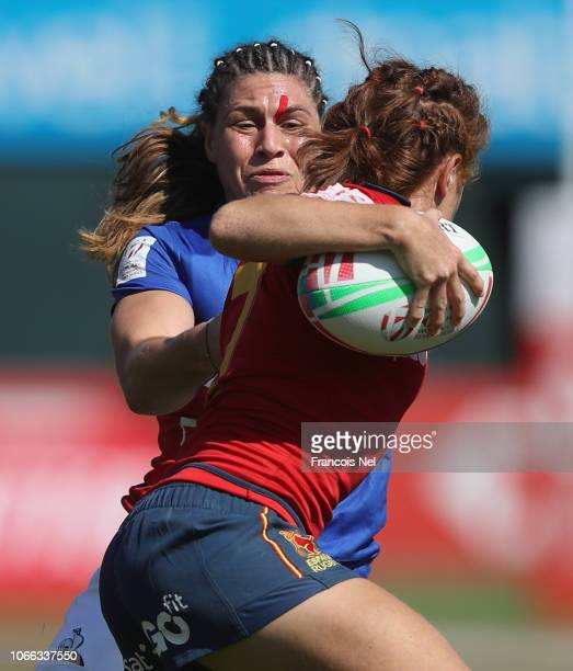 Barbara Pla of Spain is tackled by Chloe Pelle of France on day one of the Emirates Dubai Rugby Sevens HSBC World Rugby Sevens Series at The Sevens...