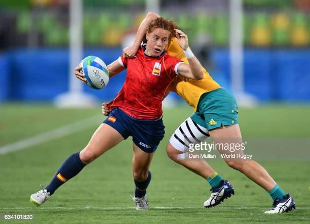 Barbara Pla of Spain is tackled by Emilee Cherry of Australia during the Women's Rugby Sevens Quarter Final match between Australia and Spain on Day...