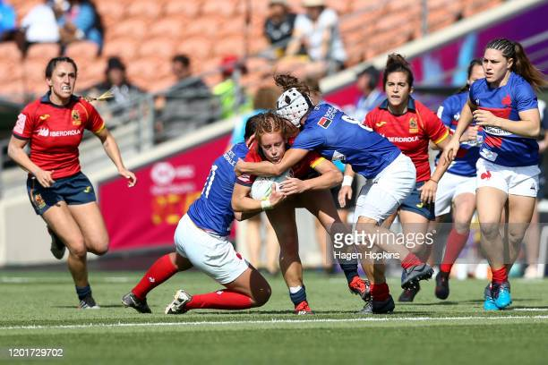 Barbara Pla of Spain is tackled by Shannon Izar and Camille Grassineau of France during the match between France and Spain at the 2020 HSBC Sevens at...