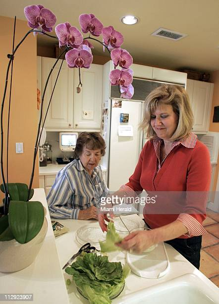Barbara Pruitt right visits with her mother Lorayne Melgaard in her Coral Gables Florida home