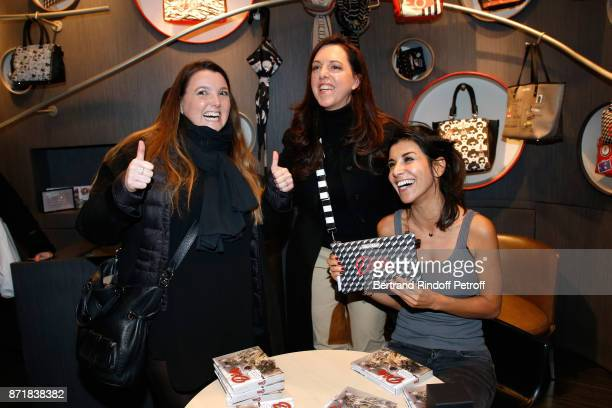 Barbara Rihl and Reem Kherici posing with a Diva Bag attend Reem Kherici signs her book Diva at the Barbara Rihl Boutique on November 8 2017 in Paris...