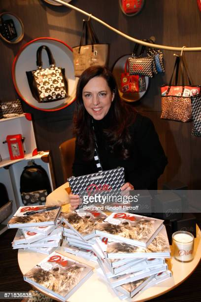 Barbara Rihl posing with the 'Diva' Bag she has created attends Reem Kherici signs her book 'Diva' at the Barbara Rihl Boutique on November 8 2017 in...