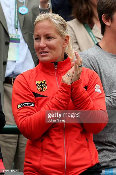 Barbara Rittner captain of the German Fed Cup team applauds Sabine Lisicki of Germany after her Ladies' Singles quarterfinal match against Kaia...