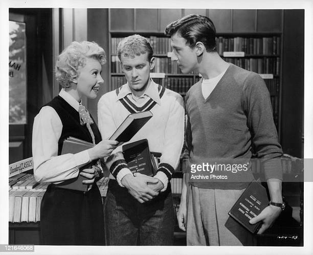 Barbara Ruick Bobby Van And Bob Fosse discuss used books in a library in a scene from the film 'Affairs Of Dobie Gillis' 1953