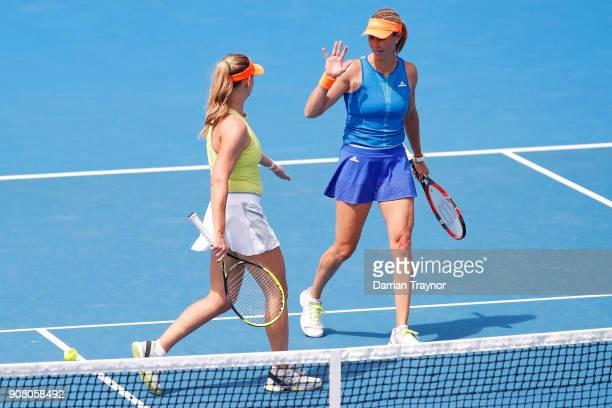 Barbara Schett of Austria and Alicia Molik of Australia talk tactics in their legend's match against Nicole Bradtke of Australia and Rennae Stubbs of...