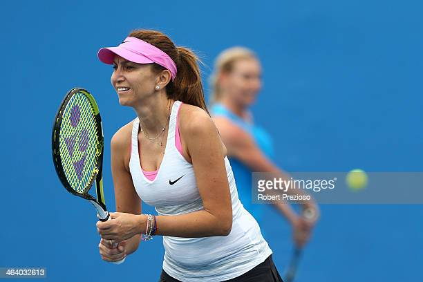 Barbara Schett of Austria and Iva Majoli of Croatia in action in their Women's Legends' Doubles match against Tracy Austin and Mary Joe Fernandez of...