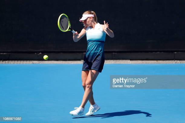 Barbara Schett of Austria plays a forehand in her Women's Legends Doubles match with Mary Joe Fernandez of the United States against Martina...