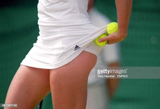 Barbara Schett puts a ball under her skirt