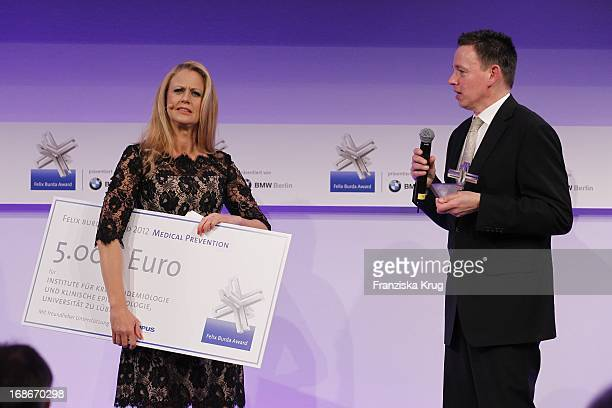 Barbara Schöneberger and Prof Alexander Katalinic at the 10th Anniversary Of The Felix Burda Award at Hotel Adlon in Berlin