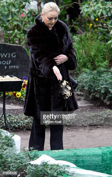 Barbara Schoene stands in front of the grave at the furneral of late German actor Harald Juhnke in Waldfriedhof Dahlem cemetery on April 2005 in...