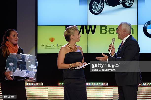 Barbara Schoeneberger and HansReiner Schroeder talk on stage at the Dreamball 2013 charity gala at Ritz Carlton on September 12 2013 in Berlin Germany