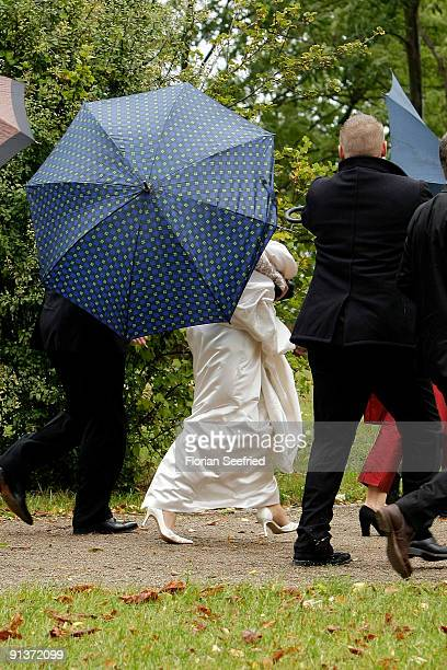 Barbara Schoeneberger arrives for her church wedding with Maximilian von Schierstaedt at the church of Rambow on October 3 2009 in Rambow Germany