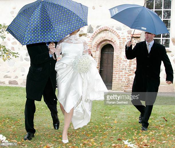 Barbara Schoeneberger leaves her church wedding with Maximilian von Schierstaedt at the church of Rambow on October 3 2009 in Rambow Germany
