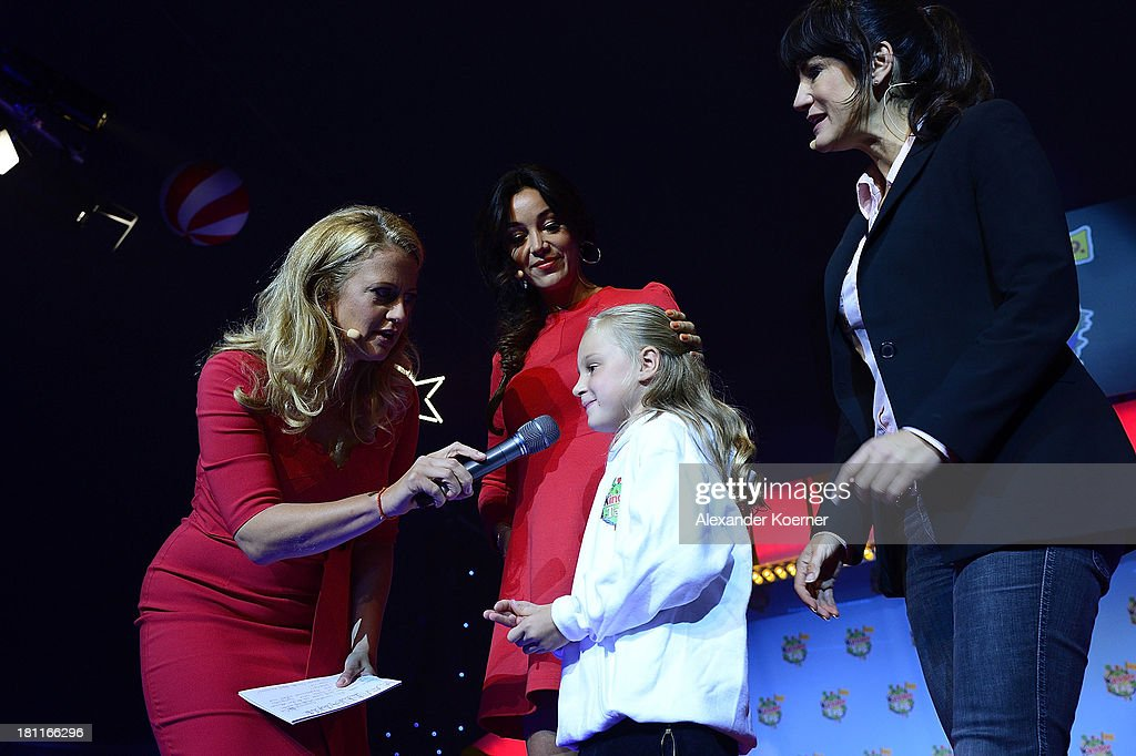 Barbara Schoeneberger, Verona Pooth, twelve year-old Naima and Mariella Ahrens are seen on stage during the Ferrero kinderTag 2013 event at Heidepark on September 19, 2013 in Soltau, Germany.