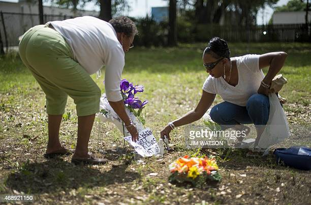 Barbara Scott cousin of Walter Scott the 50yearold man who was fired at eight times as he ran away from an officer after a traffic stop lays flowers...