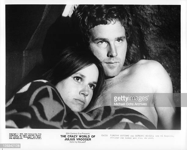 Barbara Seagull and Timothy Bottoms have an intimate moment in a scene from the film 'The Crazy World Of Julius Vrooder' 1974