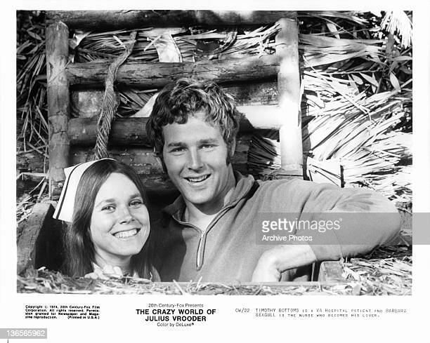 Barbara Seagull and Timothy Bottoms smiling in tree house in a scene from the film 'The Crazy World Of Julius Vrooder' 1974