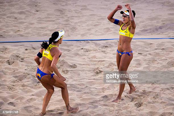 Barbara Seixas de Freitas from Brazil celebrates with teammate Agatha Bednarczuk during the FIVB Beach Volleyball World Championships Female Final...
