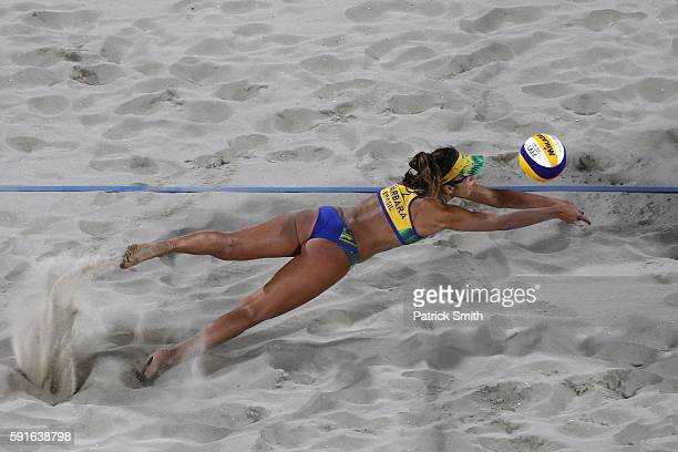 Barbara Seixas de Freitas of Brazil attempts to play a shot during the Beach Volleyball Women's Gold medal match against Laura Ludwig of Germany and...