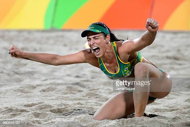 Barbara Seixas De Freitas playing with Agatha Bednarczuk Rippel of Brazil celebrate winning a point during the beach volleyball Women's Semi final...
