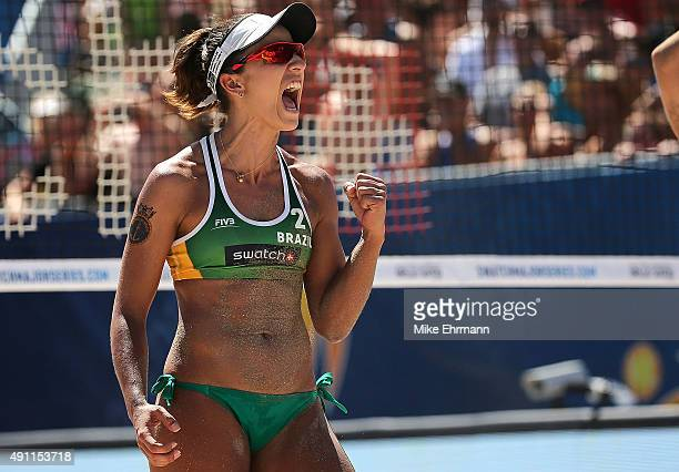 Barbara Seixas of Brazil celebrates a point during a match against Laura Ludwig and Kira Walkenhorst of Germany at the FIVB Fort Lauderdale Swatch...