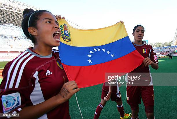 Barbara Serrano of Venezuela and team mate gabriela Garcia celebrate after the FIFA U17 Women's World Cup 2014 quarter final match between Venezuela...