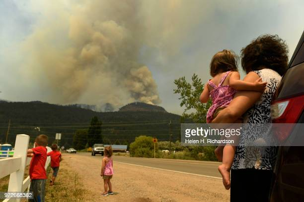 Barbara Simmons right holds her granddaughter Brynn Gammon while she and her other grandchildren from left to right Brody Blake 4 and Brielle watch...