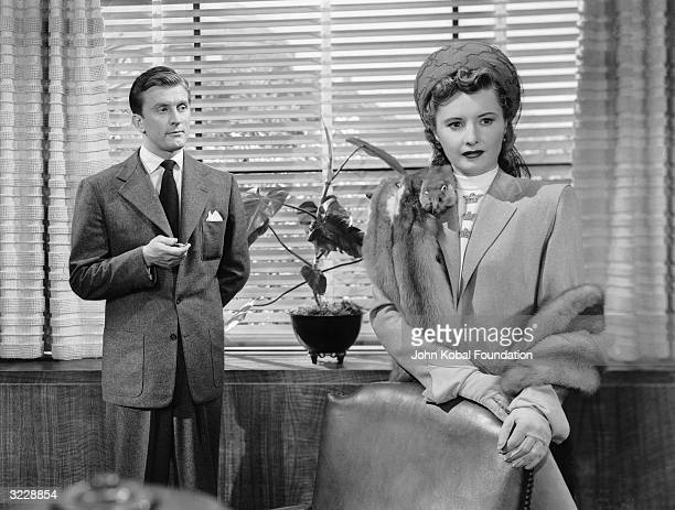 Barbara Stanwyck and Kirk Douglas play the manipulative Martha and her husband Walter O'Neil in 'The Strange Love of Martha Ivers' directed by Lewis...