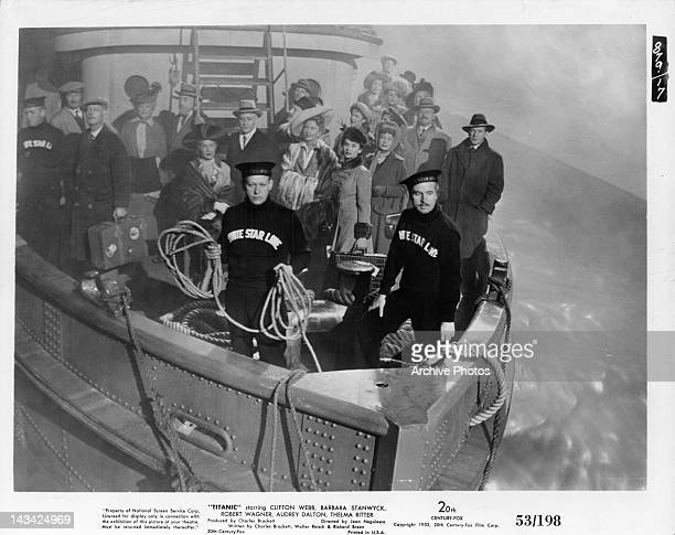 Barbara Stanwyck Audrey Dalton and Thelma Ritter stand with other passengers and crew members on the bow of the ship in a scene from the film...