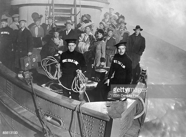 Barbara Stanwyck Audrey Dalton and Thelma Ritter stand with other passengers and crew members on the bow of the ship in a still from the film...