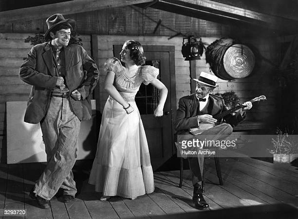 Barbara Stanwyck , Buddy Ebsen and Walter Brennan star in a scene from 'Banjo On My Knee', directed by John Cromwell for 20th Century Fox.