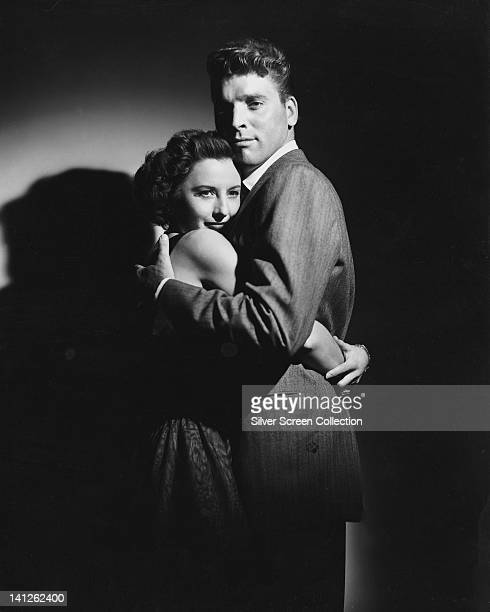 Barbara Stanwyck , US actress, and Burt Lancaster , US actor, embracing in dramatically-lit publicity portrait issued for the film, 'Sorry, Wrong...