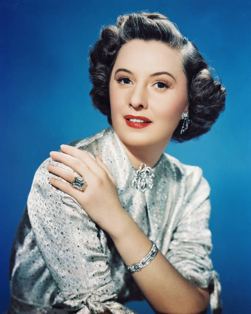 barbara-stanwyck-us-actress-poses-in-a-s