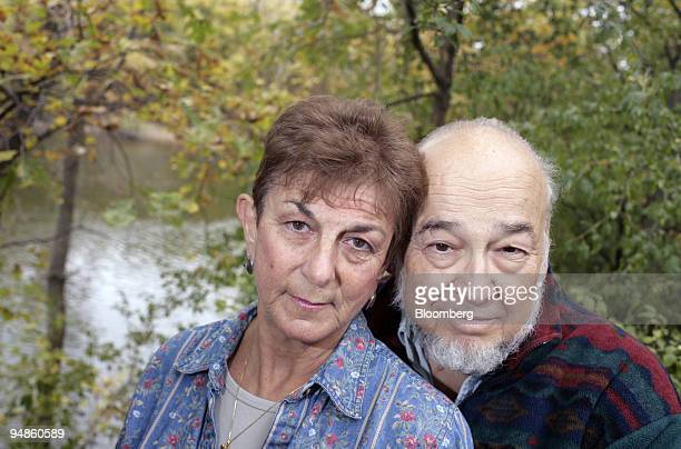 Barbara Steinmetz and her husband Howard pose for a photograph at their home on the Tittabawassee River in Saginaw, Michigan Sunday, October 23,...