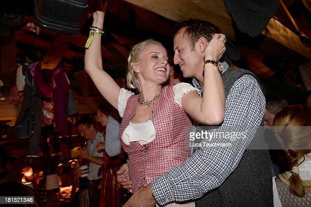 Barbara Sturm and Adam Waldman attend the Oktoberfest beer festival at the Kaefer Wiesnschaenke tent on September 21 2013 in Munich Germany