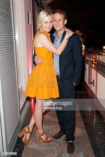 Barbara Sturm and her husband Adam Waldman attend the 'Dr Barbara Sturm NetAPorter' Dinner Party on July 21 2016 in Munich Germany