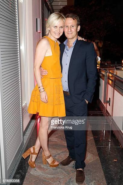 Barbara Sturm and her husband Adam Waldman attend the 'Dr Barbara Sturm NetAPorter' Dinner Party on July 21 2016 in Munich Germany