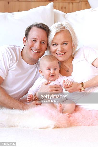 Barbara Sturm and her husband Adam Waldman pose with their newborn daughter Pepper during a portrait session at Hotel Stanglwirt on January 24 2015...