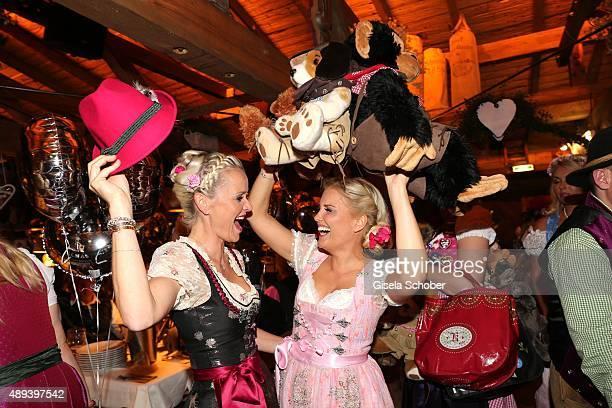 Barbara Sturm and Jennifer Knaeble with hat attend the Almauftrieb during the Oktoberfest 2015 at Kaeferschaenke beer tent on September 20 2015 in...