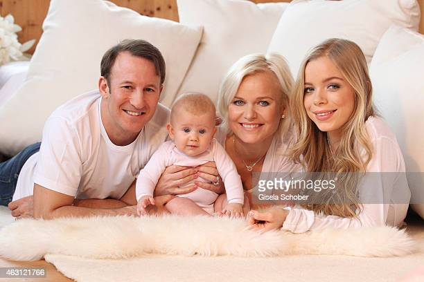 Barbara Sturm her husband Adam Waldman pose with their newborn daughter Pepper and daughter Charly Sturm during a portrait session at Hotel...
