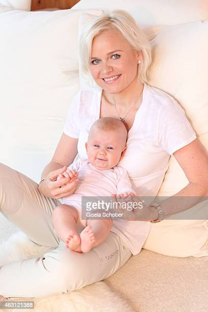 Barbara Sturm poses with her newborn daughter Pepper during a portrait session at Hotel Stanglwirt on January 24 2015 in Going Austria