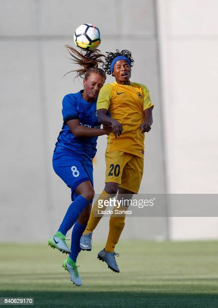 Barbara Toth of MTK Hungaria FC battles for the ball in the air with Charity Adule of WFC BIIKKazygurt during the UEFA Women's Champions League...