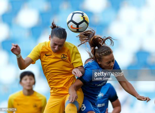 Barbara Toth of MTK Hungaria FC battles for the ball in the air with Alina Litvinenko of WFC BIIKKazygurt during the UEFA Women's Champions League...